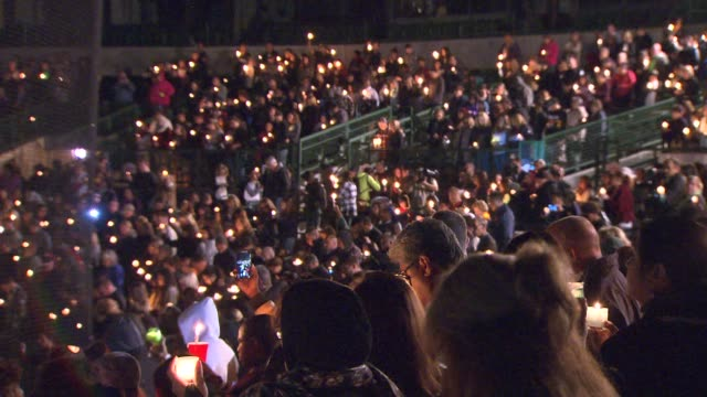 KTLA People gathered at San Manuel Stadium in San Bernardino following mass shooting that killed 14 people and injured 21