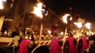 People gathered in Scotland on Tuesday for the traditional Up Helly Aa fire festival held annually in the middle of winter to mark the end of the...