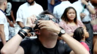 People gathered in Times Square to watch the Solar Eclipse Broadway and 7th Avenue Midtown Manhattan New York City USA