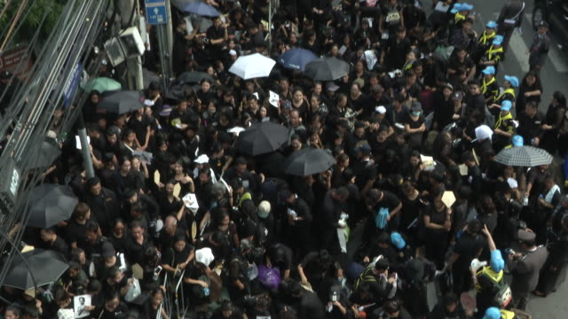 People get close to the Sanam Luang where the funeral and cremation of the late King of Thailand Bhumibol Adulyadej