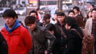 People get stand in the line at the Yeouido subway station
