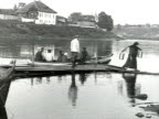 WS People getting off small boat after crossing river man getting in AUDIO/ Russia