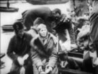 B/W 1928 people getting out of boat with Amelia Earhart in it / Southampton England / newsreel