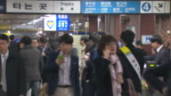 people going through ticket barrier