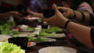 People have dinner food party together
