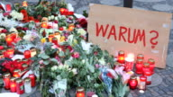 People have laid flowers for the victims of terror attacks a sign with the words 'Why' can be seen On a terrorist with a stolen truck drove into a...