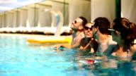 People having fun at swimming pool.