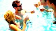 People having fun at swimming pool.