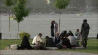 MS People having picnic on riverbank, Isfahan, Iran