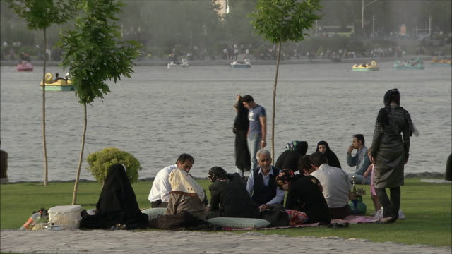 MS People having picnic on riverbank, Isfahan, Iran