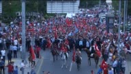 People hold Turkish flags and chant antiterror slogans during a protest against terrorist attacks on September 8 2015 in Ankara Turkey Footage by...