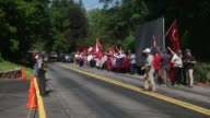 People hold Turkish flags as they gather for 'Democracy and Martyrs' Rally' near the Fettullah Gulen's residence in Pennsylvania United States on...