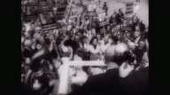 WS People holding placards and cheering, politician - LBJ - being interviewed at political rally / Unites States