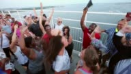 People hug sing and pray together after participating in a 'unity chain' across the Arthur Ravenel Jr Bridge over the Cooper River June 21 2015 in...