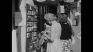 MONTAGE People in a U.K. National Park shop for postcards / UK