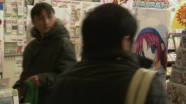 MS People in comic book store, Tokyo, Japan