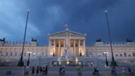WS People in front of Austrian Parliament Building at dusk / Vienna, Austria