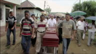 WS PAN People in funeral procession with casket / Colombia