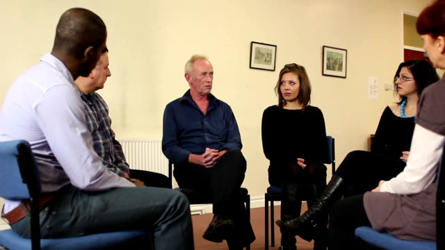 People in Group Therapy - Older man speaking
