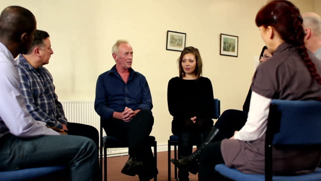People in Group Therapy - Older man speaking (DOLLY)