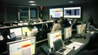/ people in JPL mission control await Atlas V launch that will take Mars Curiosity Rover to Mars / countdown clock to launch JPL Mission Control...