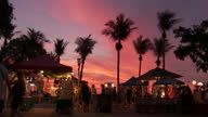 WS People in Mindil beach sunset market at sunset / Darwin, Northern Territory, Australia