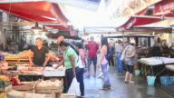 People in Ortigia Market, Syracuse (Siracusa), Sicily, Italy, Europe