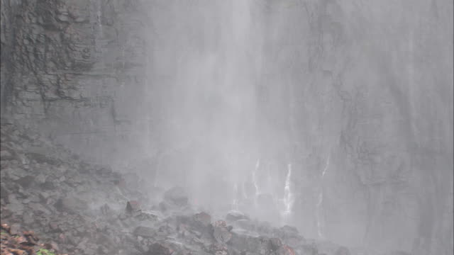 People In Raincoats At The Bottom Of Angel Falls In Auyantepui