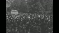 People in street / crowd gathered at Lafayette Square to watch the funeral procession of Pres Franklin Roosevelt's coffin base of the Rochambeau...