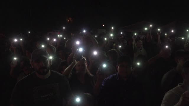 People in Sutherland Springs Texas hold a vigil to remember the 26 people killed in the nation's latest shooting massacre when a gunman with an...