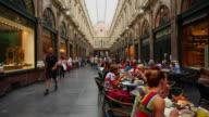 People in the Galeries Royales Saint-Hubert (Koninklijke Sint-Hubertusgalerijen) in Brussels
