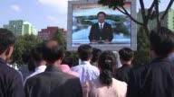 People in the North Korean capital Pyongyang watch the main news bulletin following the latest war of words between Kim JongUn and Donald Trump
