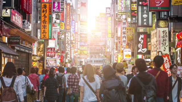 People in the streets of Shinjuku at sunset