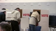 MS, People in voting booths, rear view, Ypsilanti, Michigan, USA