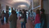 WS PAN People in Walking Gallery of El Escorial palace, Northwest of Madrid, Spain