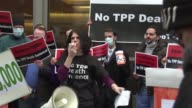 People in Washington demonstrate against the newly signed Trans Pacific Partnership deal with protestors saying it will make it difficult for...