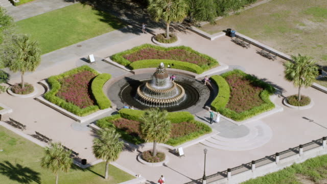 WS AERIAL POV People in Waterfront Park fountain / Charleston, South Carolina, United States