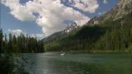People kayak on a lake in Grand Teton National Park in Wyoming.