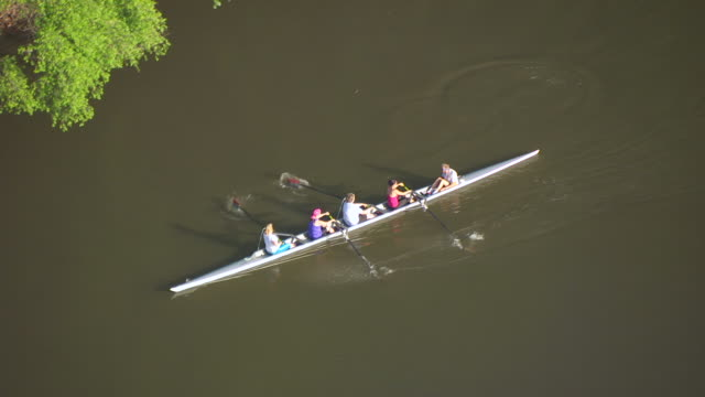 WS TS AERIAL POV People kayaking in river / Des Moines, Iowa, United States