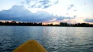 People kayaking on the lake in twilight