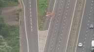 8 people killed after minibus and two lorries crash on M1 AIR VIEW Large red stain on road