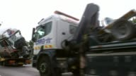 8 people killed after minibus and two lorries crash on M1 Buckinghamshire Near Newport Pagnell M1 Wreckage of vehicles involved in crash being driven...