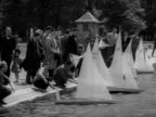 People launch model boats on a boating lake in Kensington Gardens 1957