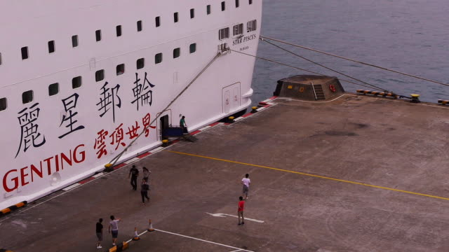 People leaving Cruise Ship at staff exit in Hong Kong Harbor