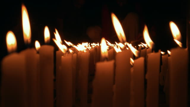 People lighting candles for a social cause