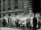 People line streets as Norman Manley Chief Minister of Jamaica arrives at 10 Downing Street for talks on visit to Britain during period of heightened...