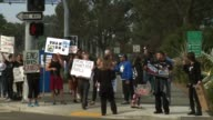 People line the streets in San Diego to protest Orca captivity at Sea World