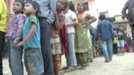 People line up at a neighborhood food distribution center / A major earthquake hit Kathmandu midday on Saturday April 25th and was followed by...