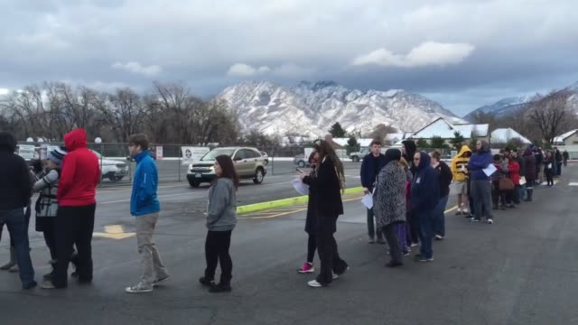 People lined up at the Mountain View Elementary Democratic caucus site in Salt Lake City to vote in the Democratic Primary election