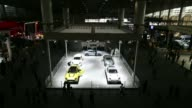 People look at the Geely GX7 at the 11th China International Automobile Exhibition in Guangzhou China on Friday Nov 22 People take photos of Aston...